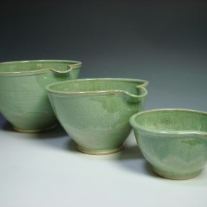 Set of three green ceramic nestling mixing bowls