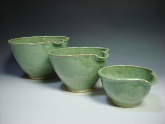 Set of three green ceramic nestling mixing bowls