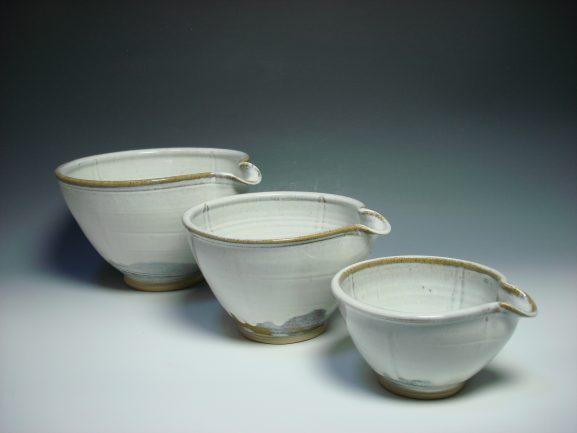 Set of three white ceramic nestling mixing bowls
