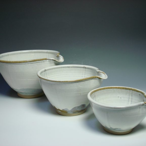 Set of three white ceramic nestling mixing bowls