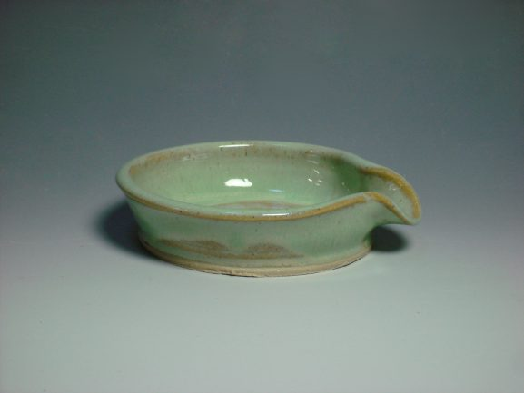 green ceramic spoon rest