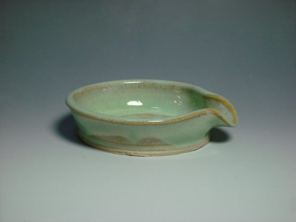green ceramic spoon rest