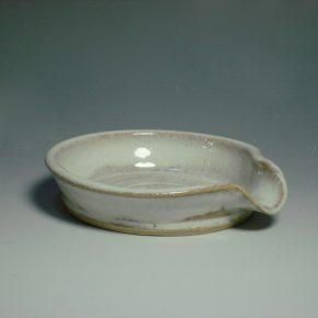 white ceramic spoon rest